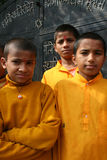 Cheerful Hindu students. In a group and posing outdoors. 2006 November 20, Devghat, Chitwan district, Nepal. Three students of Sita Ram Sanskrit Secondary Royalty Free Stock Photo