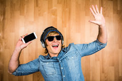 Cheerful hipster listening to music Stock Photo