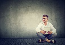 Modern man with laptop on floor royalty free stock images