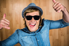 Cheerful hipster wearing sunglasses Stock Images