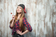 Cheerful Hipster woman with hat and candy Stock Images