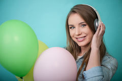 Cheerful Hipster woman with headphones and Royalty Free Stock Images