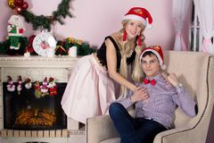 Cheerful holiday of Christmas. Happy New Year. Congratulations and gifts. Christmas, Stock Photos