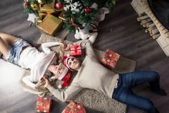 Cheerful holiday of Christmas. Happy New Year. Congratulations and gifts. Christmas,. Winter Stock Photos