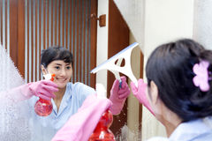 Cheerful hotel maid Royalty Free Stock Photography
