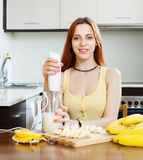 Cheerful housewife cooking with bananas Stock Photography