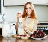 Cheerful housewife cooking with cherry Stock Photos