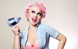 Cheerful housewife with hairdryer Stock Image