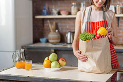 Cheerful housewife holding shopping package Royalty Free Stock Photos