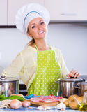 Cheerful housewife at kitchen Royalty Free Stock Image