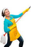 Cheerful housewife playing the mop like a guitar Royalty Free Stock Photography