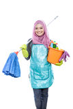 Cheerful housewife wearing hijab holding mop and carrying a buck Royalty Free Stock Image