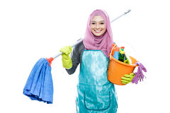 Cheerful housewife wearing hijab holding mop and carrying a buck Royalty Free Stock Photography