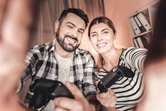 Cheerful husband and wife having a day off at home Royalty Free Stock Images