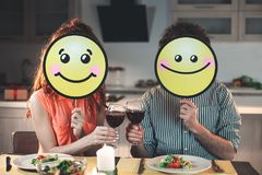 Cheerful husband and wife smiling during romantic dinner stock photo