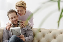 Cheerful husband and wife watching family photo Royalty Free Stock Image