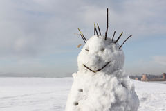 The cheerful incomplete snowman standing against the sky Royalty Free Stock Images