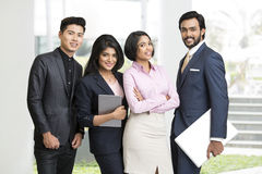 Cheerful Indian business people team. Standing front of office Stock Images