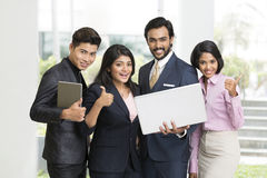 Cheerful Indian businessman standing with his team Stock Images