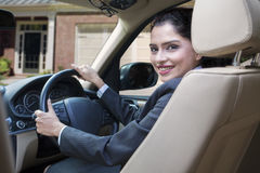 Cheerful indian woman driving new car Royalty Free Stock Images