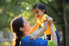 Free Cheerful Indian Woman Holding Baby Boy Royalty Free Stock Photo - 140303135