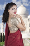 Cheerful Indian woman with Taj Mahal background Stock Photo