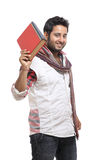 Cheerful indian young man with book Royalty Free Stock Photography