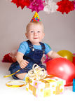 Cheerful infant in a party hat Royalty Free Stock Images