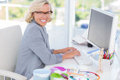 Cheerful interior designer working on her computer Royalty Free Stock Image