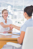 Cheerful interviewer shaking hand of an applicant Stock Image