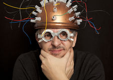 Cheerful inventor helmet for brain research Royalty Free Stock Photography