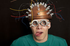 Cheerful inventor helmet for brain research Stock Photos