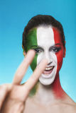 Cheerful italian supporter for FIFA 2014 stock photo