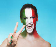 Cheerful italian supporter for FIFA 2014 gesturing Royalty Free Stock Photos
