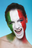 Cheerful italian supporter for FIFA 2014 looking Royalty Free Stock Image