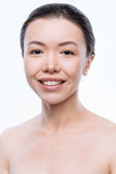 Cheerful Japanese woman smiling. Joyfulness. Delighted pleasant young woman smiling and expressing happiness while standing isolated in white background Royalty Free Stock Photo