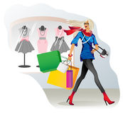 A cheerful and joyful girl goes shopping with Stock Image