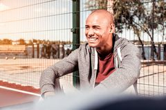 Cheerful joyful man being in a great mood stock photography