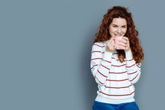 Cheerful joyful woman having tea Royalty Free Stock Photo