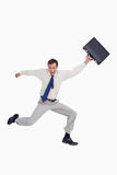 Cheerful jumping businessman with his suitcase Royalty Free Stock Photography