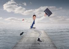 Cheerful jumping businessman with his suitcase Royalty Free Stock Image