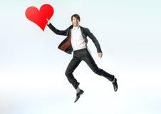 Cheerful jumping man witha big heart Stock Photo