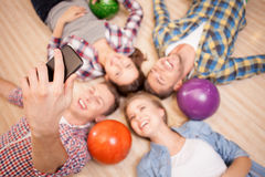 Cheerful kegling team is resting after game Royalty Free Stock Images