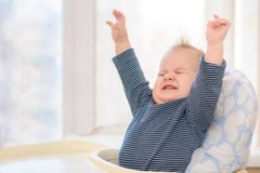 Cheerful kid with admiration his hands up royalty free stock photography
