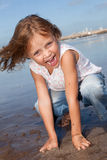 Cheerful kid at the beach Stock Image