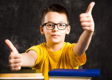 Cheerful kid with books ready for school. Cheerful kid with pile of books ready for school Royalty Free Stock Photo