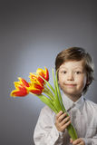 Cheerful kid with flowers Royalty Free Stock Photo