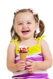 Cheerful kid girl eating ice-cream isolated Royalty Free Stock Image