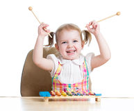 Cheerful kid girl playing Royalty Free Stock Images