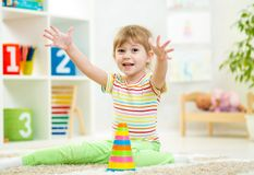 Cheerful kid girl playing at children room Royalty Free Stock Photo